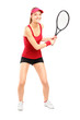 Full length portrait of female tennis player holding a racket