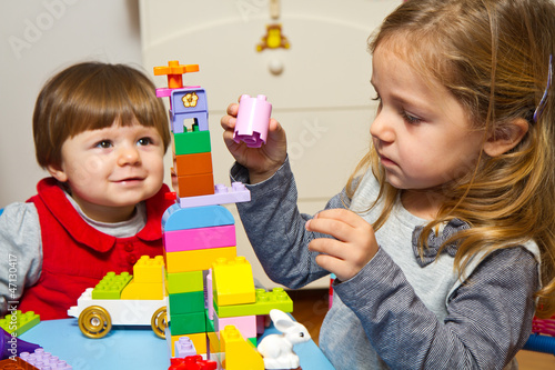Little girls playing with building bricks