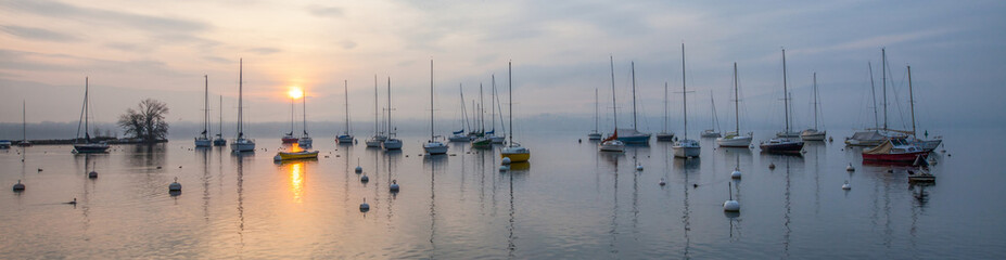 Panoramic view of Boats and Sunrise