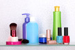Shelf with cosmetics and toiletries in bathroom