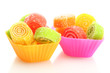 sweet jelly candies in cup cake cases isolated on white.