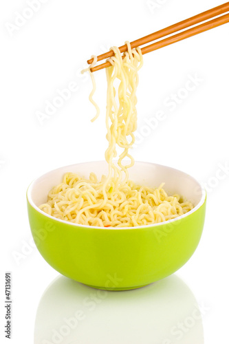chopsticks holding asian noodles isolated on white