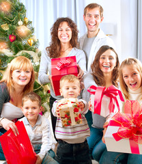 Happy Big Family with Christmas Gifts at Home