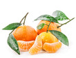 Tangerines with green leaves isolated on white background