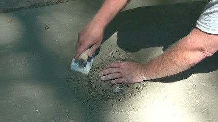 Man Edges and Smooths Out Cement