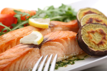 dish of roasted salmon with sweet potatoes