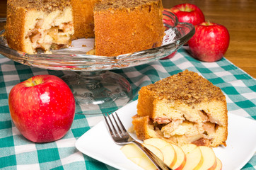 Apple cake on display with red apple