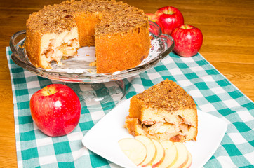 Apple cake with sliced apples on plate