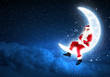 photo of santa claus sitting on the moon