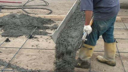 Men Pour Concrete over Rebar