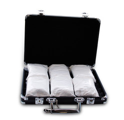 Drugs in a suitcase (really it's powdered sugar)