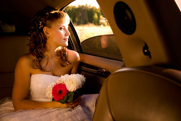 Bride is sitting in limousine