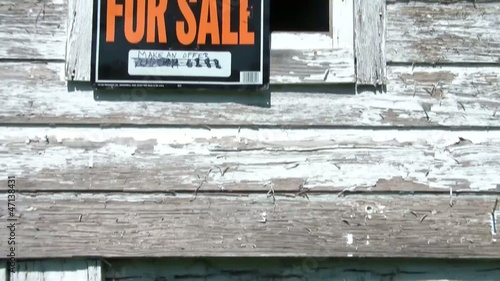 For Sale Sign Irony on Abandoned Building