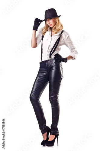 Attractive woman dancing in leather suit