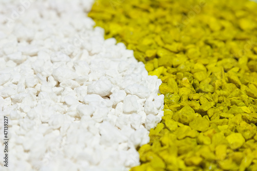 A closeup of colorful white and green stones sand