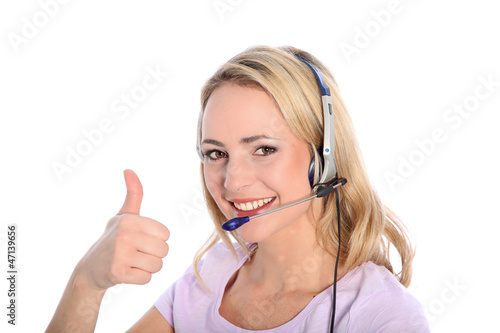 Happy young call operator or receptionist