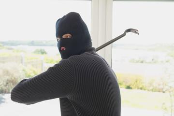 Burglar swinging crow bar