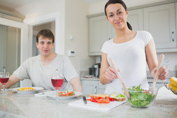 Smiling couple having lunch at home