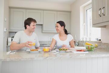 Young couple enjoying lunch