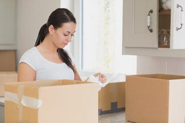 Woman unpacking in kitchen