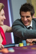 Couple smiling at each other at roulette table