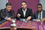 Three men playing roulette