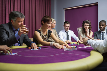 People sitting playing poker
