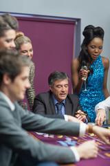 Women watching men placing bets