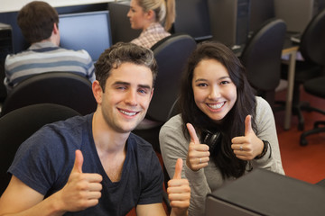 Happy students giving thumbs up