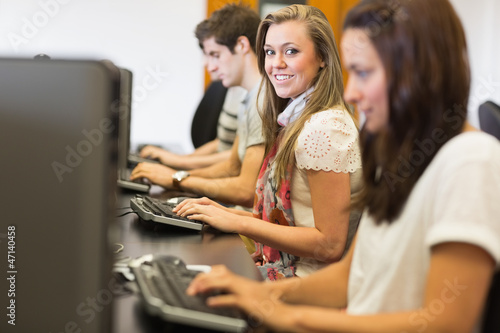 Students sitting at the computer smiling