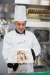 Chef looking at his dish