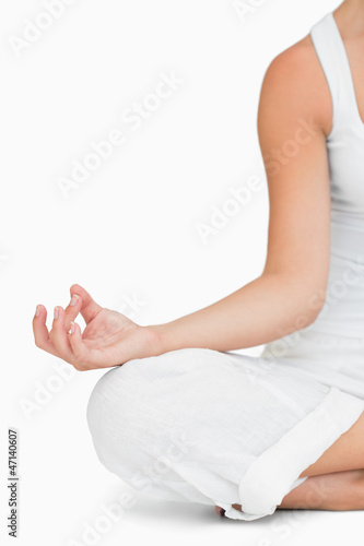 Woman doing yoga while sitting