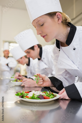 Chef preparing a salad in class