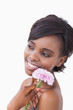 Woman holding a pink coloured flower