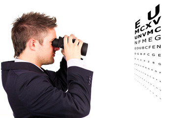 Man doing an eye test with binoculars