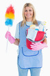 Cleaning woman holding feather duster with a bucket