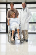 Pregnant woman in wheelchair, partner and doctor smiling