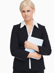 Serious businesswoman holding a tactile tablet