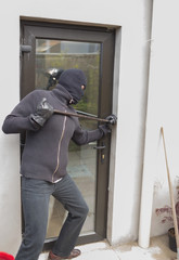 Burglar breaking door