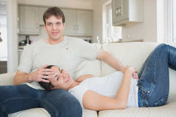 Prospective parents lying on the couch