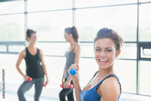 Women talking in aerobics class
