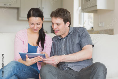 Two people using a tablet computer