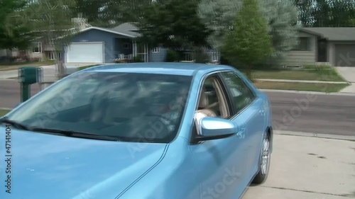Old Lady Driving Car into Driveway