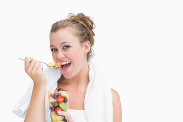 Woman eating fruit and smiling