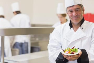 Chef presenting his salad