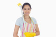 Happy woman with a broom on her shoulder