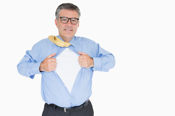 Happy man with glasses is pulling his shirt with his hands