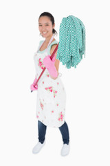 Woman holding a mop with gloves on