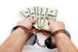 Shackled hands holding dollars
