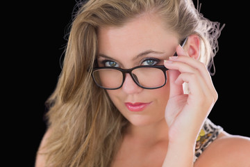 Sexy woman holding her glasses